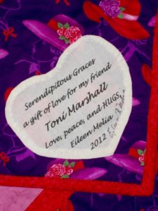 Appliquéd signature heart of Serendipitous Graces Quilt